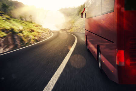 Bus driving on road with landscape background Stock Photo