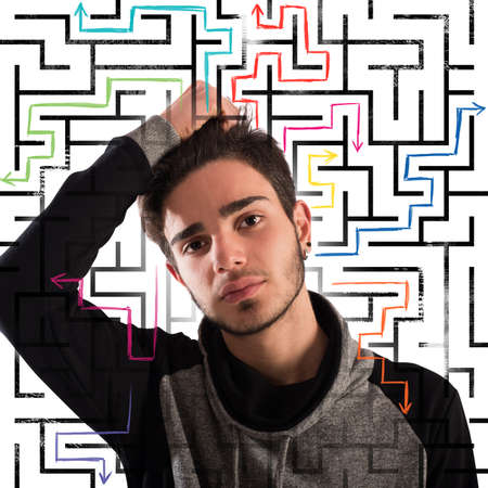 difficult to find: Boy with thoughtful expression with maze background
