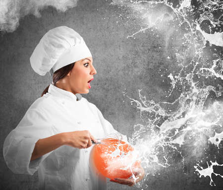woman squirt: Chef sees cream squirts out of bowl Stock Photo