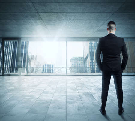 building business: Businessman in an office overlooking the city
