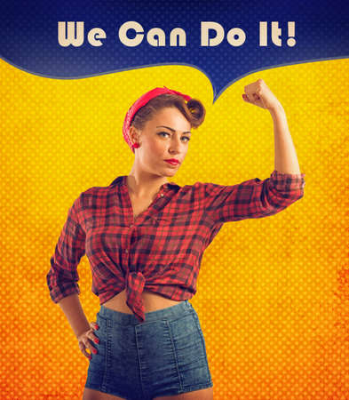 Pin-up style woman show her muscular biceps Stock Photo