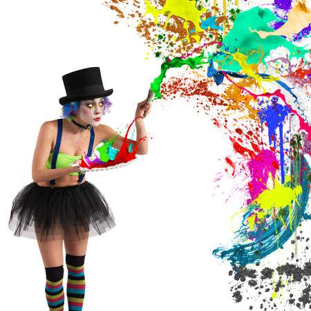 splatter paint: Painter clown paints with brush and palette Stock Photo