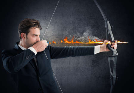 Man with bow and arrow on fire