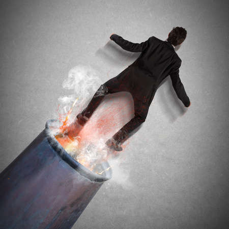 risky job: Businessman is shot out of a cannon
