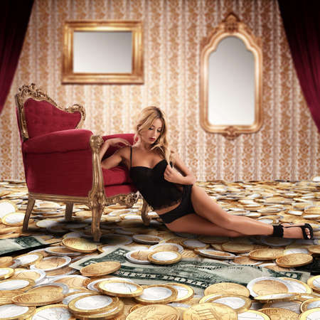 Woman leaning against armchair on money floor Reklamní fotografie