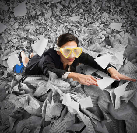 paperwork: Businesswoman with mask swims between the sheets