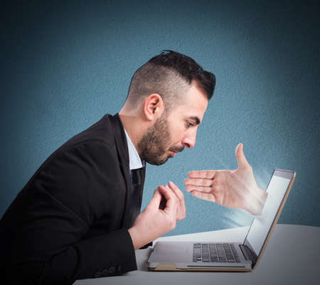 coming out: Man with hand coming out from computer