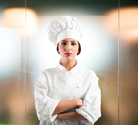 cater: Woman chef with hat and apron posing