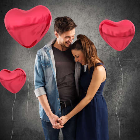 tender sentiment: Smiling couple embracing with red heart balloons