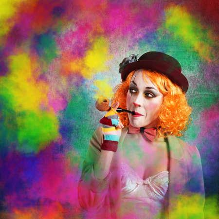 colored smoke: Clown smoking a pipe with colored smoke