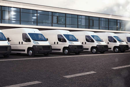 delivery van: Line of trucks parked on the road Stock Photo