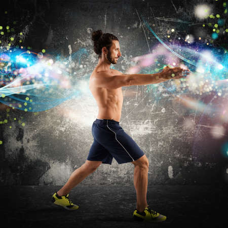 exertion: Man fitness posture with light effects background