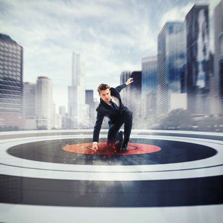 Businessman at the center of a target Stock Photo - 54020348
