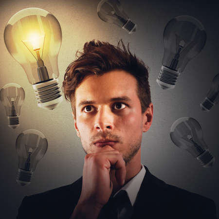 intuition: Man with thoughtful expression with bulbs background