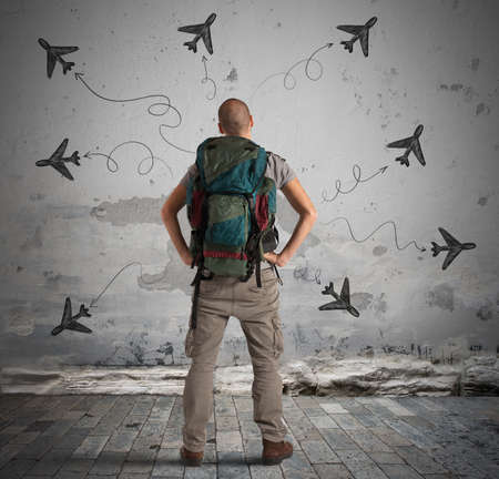 thinks: Man explorer with planes drawn around him Stock Photo