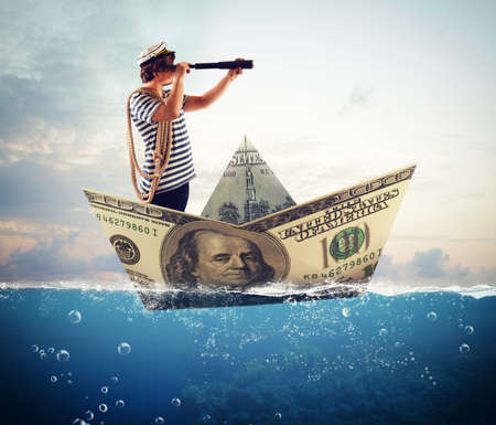 banknote: Sailor with binoculars on big banknote boat Stock Photo
