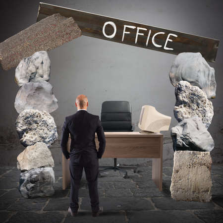 Man looks at an office with rocks Stock Photo