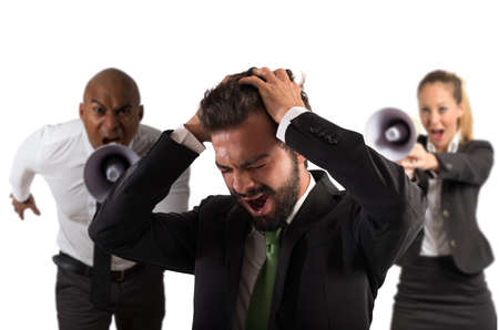 reprimand: Boss scolds with megaphone a desperate employee Stock Photo