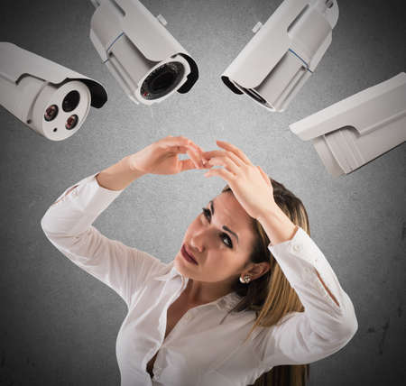 fear woman: Businesswoman covers her face annoyed by cameras Stock Photo