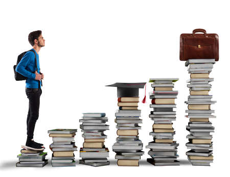 attain: Boy climbing the stairs made of books Stock Photo