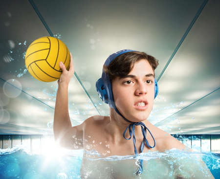 polo player: Water polo boy player pulls a ball