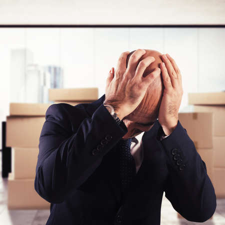 desperate: Desperate man with cardboard stack on background Stock Photo
