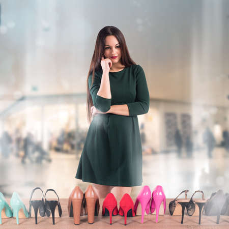undecided: Woman undecided in front of shoes showcase