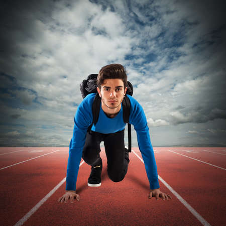 Teenager boy with backpack ready to run Stock Photo