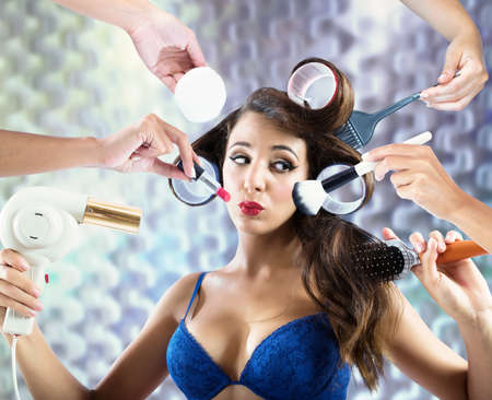 hair drier: Girl gets her make-up and hair styled Stock Photo