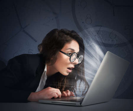 work addicted: Businesswoman with eyeglasses writes at the computer