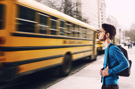 Teenager student with backpack waiting for bus