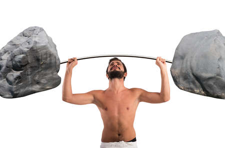 Goofy guy lifting a barbell with boulders Stock Photo