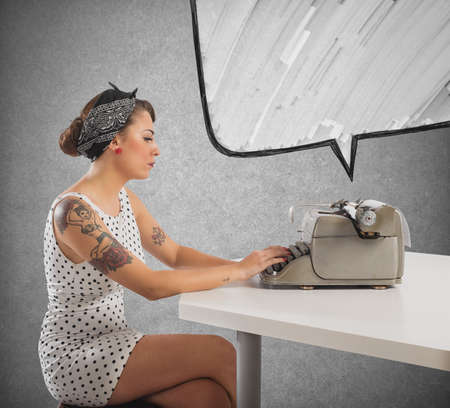 tattooed: Pretty pin-up girl writes with a typewriter