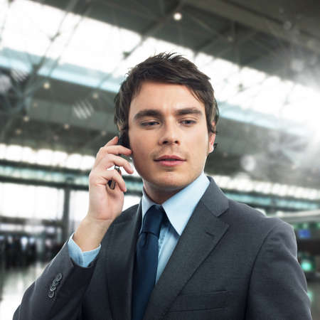 communicative: Confident and successful businessman talking on cellphone