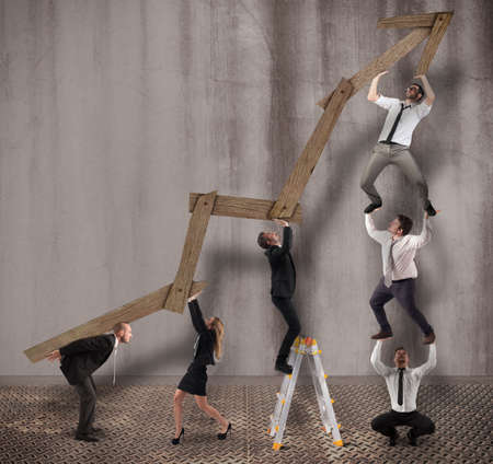 ascend: Teamwork build an arrow upwards of wood Stock Photo