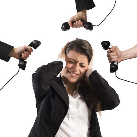 annoyed: Businesswoman stressed and annoyed by business calls Stock Photo