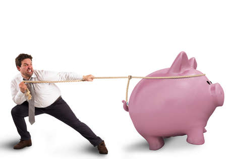 savings problems: Man pulls the rope with a piggybank