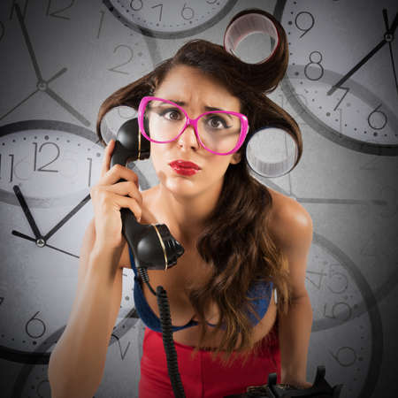 Airhead pin-up mazed girl with watches background Stock Photo
