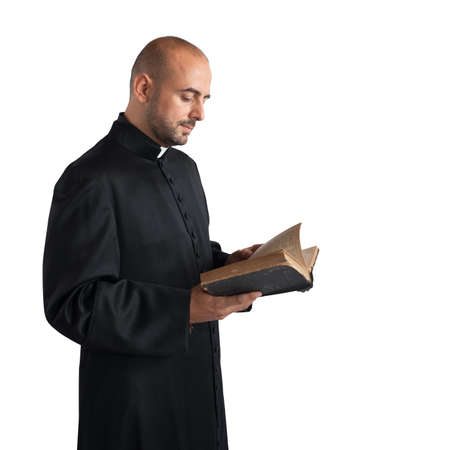 preaching: Man priest reads the bible sacred text Stock Photo