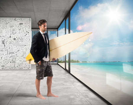 Businessman with suit and swimsuit at office Stock Photo