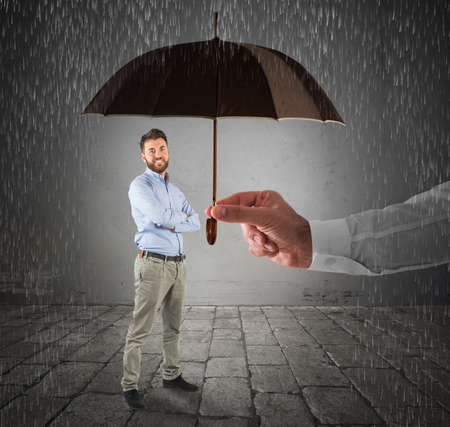 Man covered by an umbrella of person