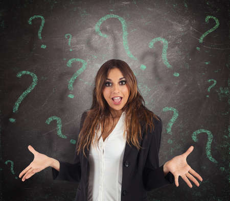 incertitude: Confused businesswoman with green question marks background