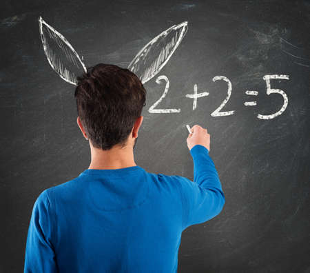 ロバの耳を持つ学生が算術演算を書き込みます 写真素材