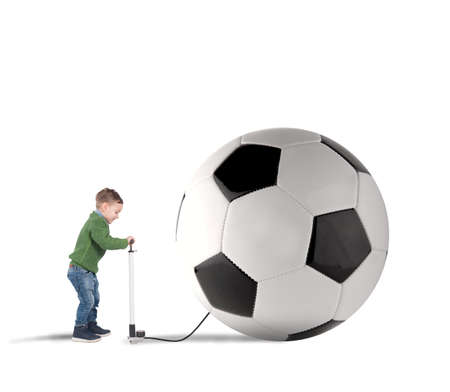 desired: Baby boy amused swollen a big soccer ball Stock Photo