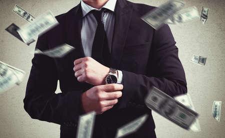Rich Man mit Clock und Geld Hintergrund Standard-Bild - 56470691