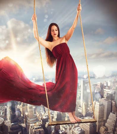 waft: Girl on a swing above the city