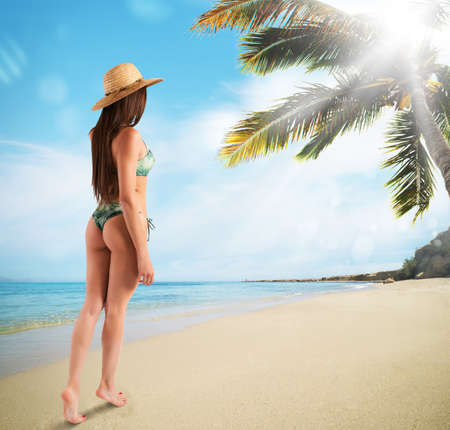 shore: Woman walking on the tropical beach shore Stock Photo