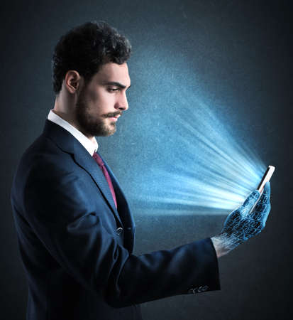 work addicted: Man with cell phone in his hand
