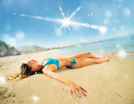 relaxing beach: Girl lying on the sand at the beach Stock Photo
