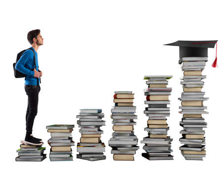 step ladder: Boy climbing the stairs made of books Stock Photo